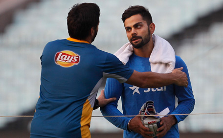 Pakistan's Shahid Afridi talks to India's Virat Kohli during a training session ahead of the ICC World Twenty20 2016 match against India in Kolkata, India, Friday, March 18, 2016. Pakistan is yet to win against India at any World Cup or World Twenty20. (AP)