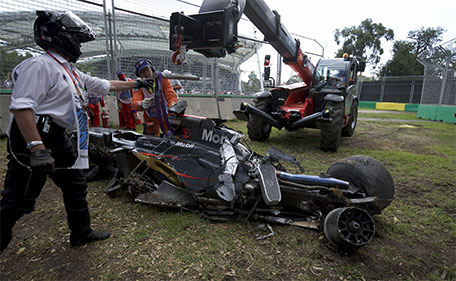 The McLaren of F1 driver Fernando Alonso is retrieved following a crash with Haas F1 driver Esteban Gutierrez at the Australian Formula One Grand Prix in Melbourne, Australia - 20/03/16. (Reuters)