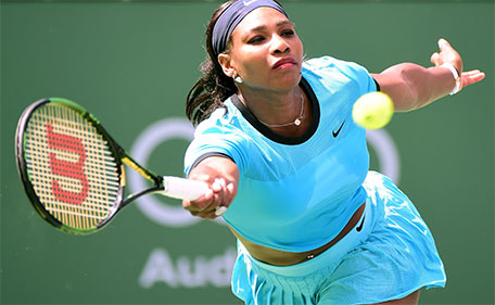 Serena Williams of the United States returns serve as she loses to Victoria Azarenka of Belarus in the WTA Singles Final during day fourteen of the 2016 BNP Parisbas Open at Indian Wells Tennis Garden on March 20, 2016 in Indian Wells, California. (AFP)