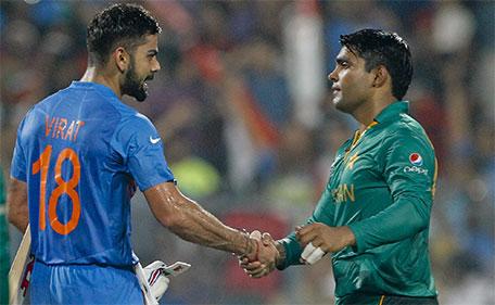 Pakistan's Umar Akmal congratulates India's Virat Kohli, left after India won the ICC World Twenty20 2016 cricket match against Pakistan at Eden Gardens in Kolkata, India, Saturday, March 19, 2016. India won by six wickets. (AP)