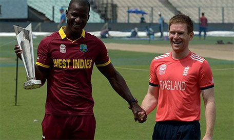 West Indies captain Darren Sammy (left) and England captain Eoin Morgan pose with the World T20 trophy. (AFP)