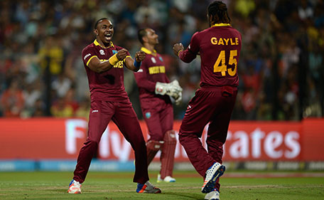 Dwayne Bravo of the West Indies celebrates with Chris Gayle after dismissing Ben Stokes of England during the ICC World Twenty20 India 2016 Final between England and the West Indies at Eden Gardens on April 3, 2016 in Kolkata, India. (Getty Images)