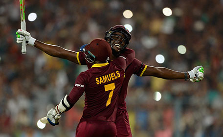 Carlos Brathwaite of the West Indies celebrates hitting the winning runs with Marlon Samuels to win the ICC World Twenty20 India 2016 Final between England and the West Indies at Eden Gardens on April 3, 2016 in Kolkata, India. (Getty Images)