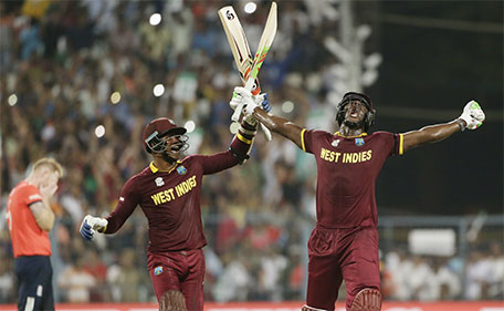 West Indies Carlos Brathwaite (right) celebrates with teammate Marlon Samuels after they defeated in England in the final of the ICC World Twenty20 2016 cricket tournament at Eden Gardens in Kolkata, India, Sunday, April 3, 2016. (AP)