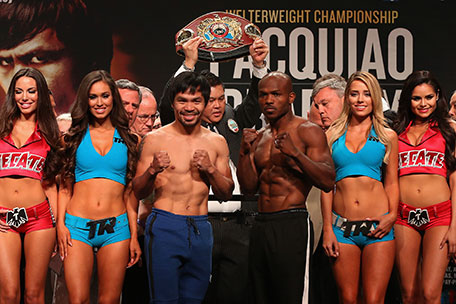Manny Pacquiao and Timothy Bradley Jr. pose during their official weigh-in at MGM Grand Garden Arena on April 8, 2016 in Las Vegas, Nevada. The two will meet in a welterweight fight on April 9 in Las Vegas. (Getty Images)