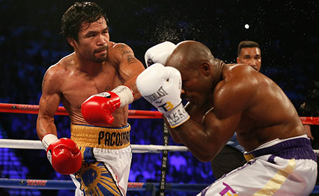 Manny Pacquiao (left) throws a left against Timothy Bradley Jr. during their welterweight championship fight on April 9, 2016 at MGM Grand Garden Arena in Las Vegas, Nevada. Manny Pacquiao won by unanimous decision. (Getty Images)
