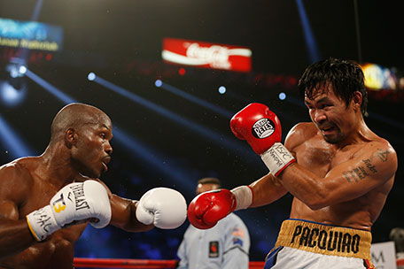 Timothy Bradley Jr. (left) throws a left against Manny Pacquiao during their welterweight championship fight on April 9, 2016 at MGM Grand Garden Arena in Las Vegas, Nevada. Pacquiao won by unanimous decision. (Getty Images)