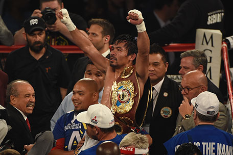 Manny Pacquiao celebrates as he leaves the ring after defeating Timothy Bradley Jr. in their welterweight championship fight on April 9, 2016 at MGM Grand Garden Arena in Las Vegas, Nevada. Pacquiao won by unanimous decision. (Getty Images)