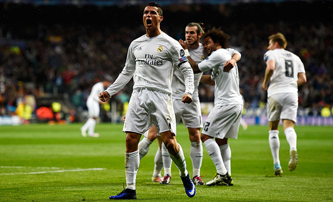Cristiano Ronaldo of Real Madrid (7) celebrates with team mates as he scores their second goal during the UEFA Champions League quarter final second leg match between Real Madrid CF and VfL Wolfsburg at Estadio Santiago Bernabeu on April 12, 2016 in Madrid, Spain. (Getty Images)