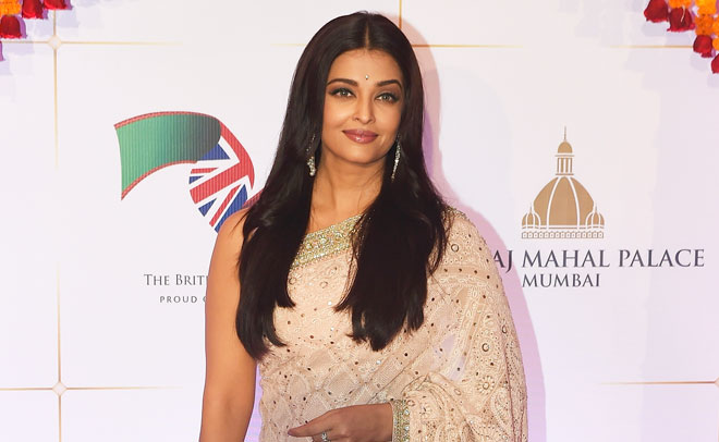 Bollywood actress Aishwarya Rai Bachchan poses for photographers after arriving for a charity ball at the Taj Mahal Palace hotel attended by the Duke of Cambridge, Prince William, and his wife, Kate, the Duchess of Cambridge, in Mumbai, India, Sunday, April 10, 2016. (AP)