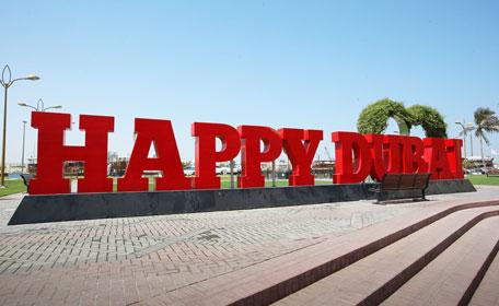 A logo for 'Happy Dubai' seen on the Creek Deira in Dubai. (Ashok Verma)