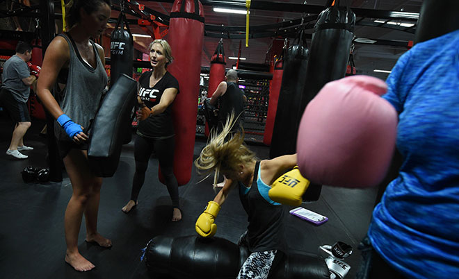 Brooke Carlucci (centre) trains with other students in a Mixed Martial Arts class at the UFC Gym in La Mirada, California on April 30, 2016. (AFP)