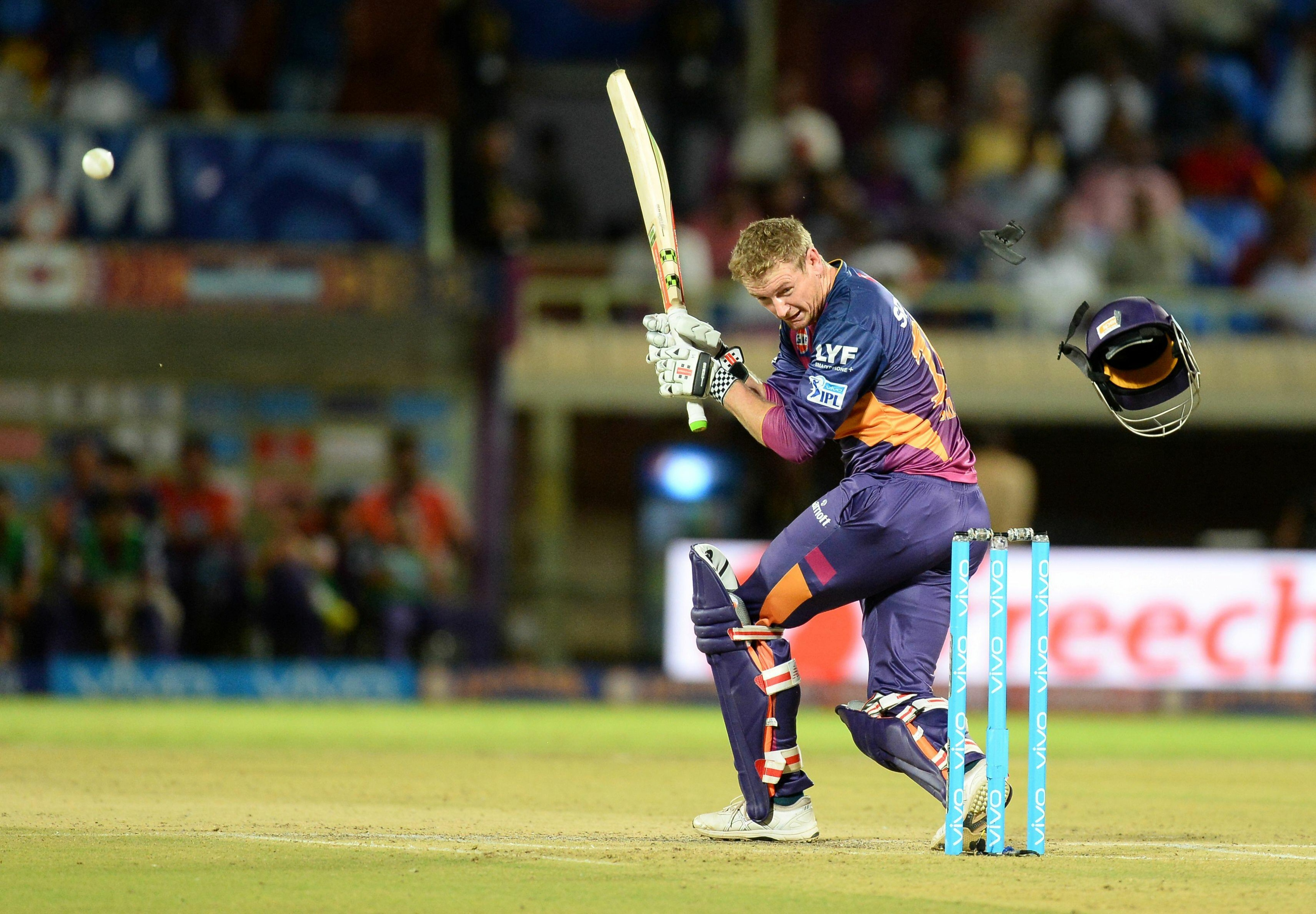 The helmet of rising Pune Supergiants batsman George Bailey  falls down after it was hit by a ball during the 2016 Indian Premier League (IPL) Twenty20 cricket match between Rising Pune Supergiants  and Delhi Daredevils at Dr. Y.S. Rajasekhara Reddy ACA-VDCA Cricket Stadium in Visakhapatnam on May 17, 2016. (AFP)
