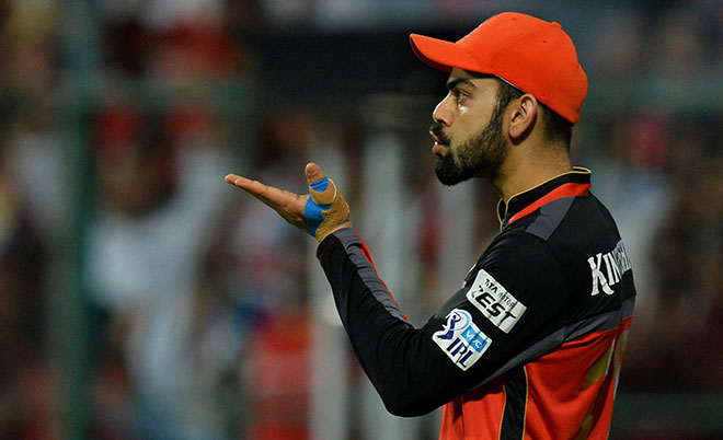Royal Challengers Bangalore captain Virat Kohli blows a kiss after taking a catch to dismiss Gujarat Lions batsman Dwayne Smith during the 2016 Indian Premier League (IPL) Twenty20 first qualifiers cricket match between Royal Challengers Bangalore and Gujarat Lions at The M. Chinnaswamy Stadium in Bangalore on May 24, 2016. (AFP)