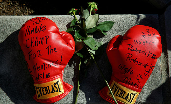 Boxing gloves with well wishes are left at a makeshift memorial for late boxing champion Muhammad Ali in Louisville, Kentucky, , U.S., June 8, 2016. (Reuters)