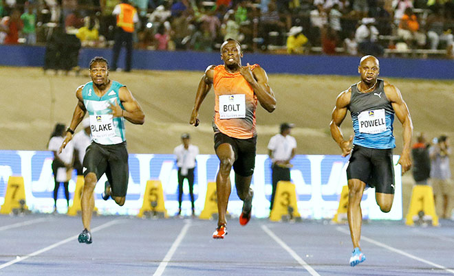 Yohan Blake (left), Usain Bolt (centre) and Asafa Powell in action during men's 100m race at Jamaica National Racers Grand Prix in Kingston - 11/06/16. (Reuters)