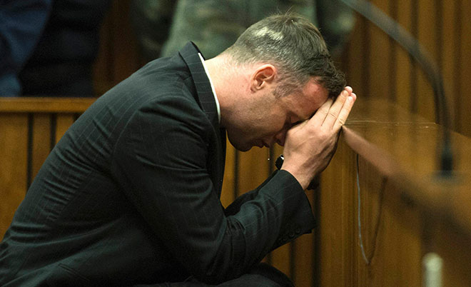 South African Paralympian Oscar Pistorius breaks down at the Pretoria High Court on June 14, 2016 on the second day of his pre sentencing hearing set to send him back to jail for murdering his girlfriend three years ago. (AFP)
