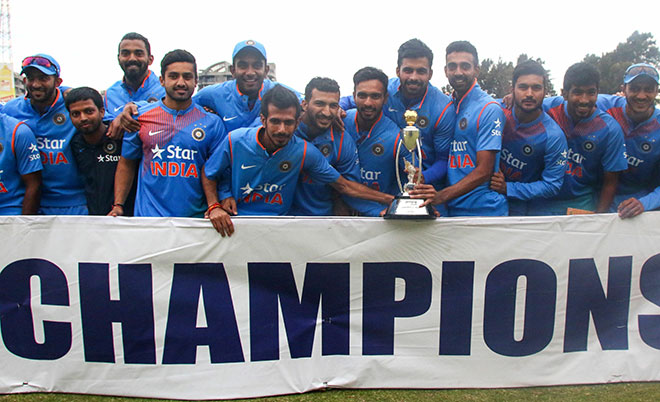 India's players pose with the Prayag Series Trophy after winning the third and final T20 cricket match in a series of three games between India and Zimbabwe in the Prayag Cup at Harare Sports Club, in Harare, on June 22 2016. (AFP)