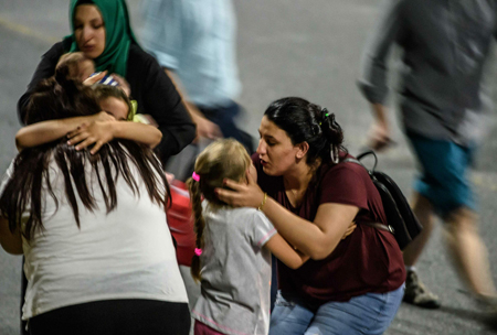 Children and their relatives embrace as they leave Ataturk airport on June 28, 2016 in Istanbul after two explosions followed by gunfire hit Turkey's biggest airport, killing at least 28 people and injuring 20. (AFP)
