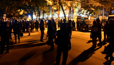 Bangladeshi security personnel stand guard outside a restaurant during an attack in Dhaka's high-security diplomatic district early on July 2, 2016.(AFP)