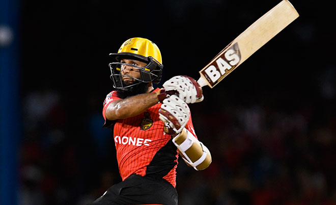 Hashim Amla hits of Trinbago Knight Riders hits 6 during Match 3 of the Hero Caribbean Premier League between Trinbago Knight Riders and Tridents at Queen's Park Oval in Port of Spain, Trinidad. (CPL/Sportsfile)