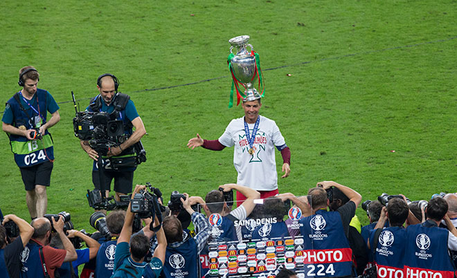Portugal's Cristiano Ronaldo poses with the winners trophy during the UEFA Euro 2016 Final match between Portugal and France at Stade de Lyon on July 10 in Paris, France. (CameraSport via Getty Images)