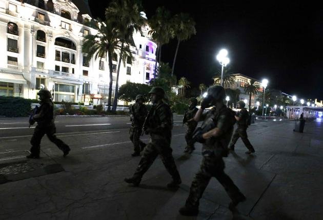 French soldiers advance on the street after at least 30 people were killed in Nice, France, when a truck ran into a crowd celebrating the Bastille Day national holiday July 14, 2016 (Reuters)