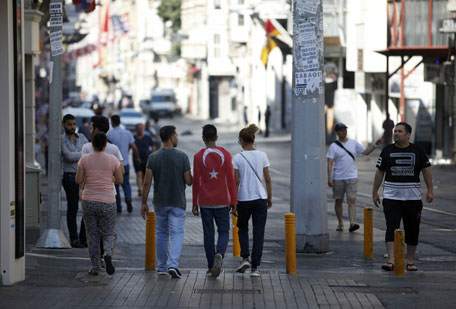 People walk in the streets near Taksim Square in Istanbul after an attempted coup in Turkey, July 16, 2016. (Reuters)