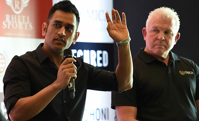Former Australian cricketer Craig McDermott (right) watches as Indian cricketer Mahendra Singh Dhoni speaks during a promotional event in New Delhi on July 20, 2016.(AFP)