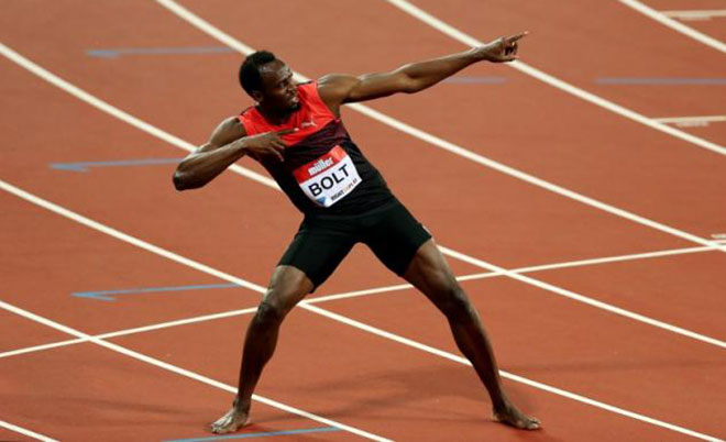 Jamaica's Usain Bolt celebrates winning the Men's 200m. (Action Images via Reuters)