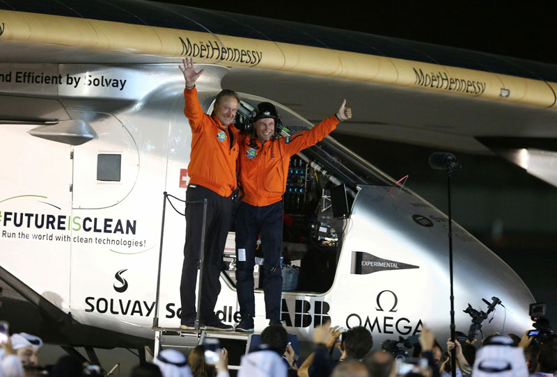 Pilots Andre Borschberg (L) and Bertrand Piccard celebrate after their arrival on Solar Impulse 2 in Abu Dhabi on July 26, 2016 (Reuters)
