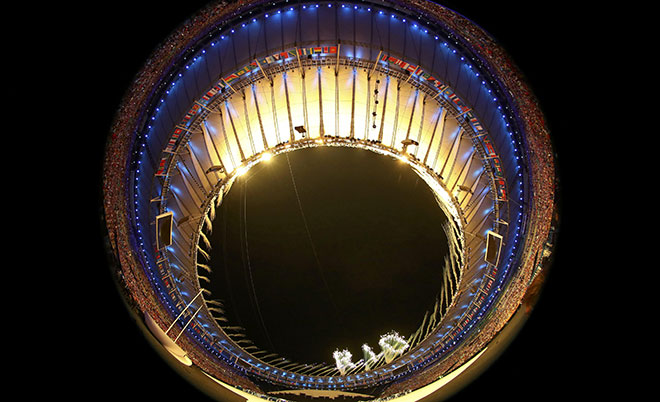 Fireworks are seen during the opening ceremony. Picture taken with a fisheye lens. (Reuters)