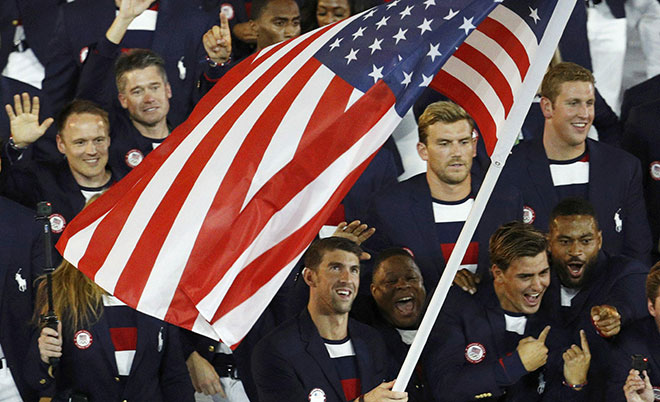 lagbearer Michael Phelps (USA) of United States of America leads his contingent during the opening ceremony. (Reuters)