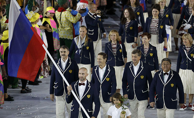 Flagbearer Sergey Tetyukhin (RUS) of Russia leads his contingent during the opening ceremony. (Reuters)