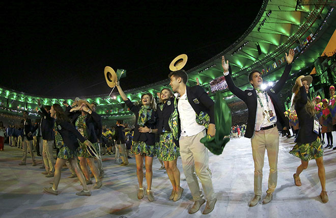 Brazil arrive in the stadium for the opening ceremony. (Reuters)