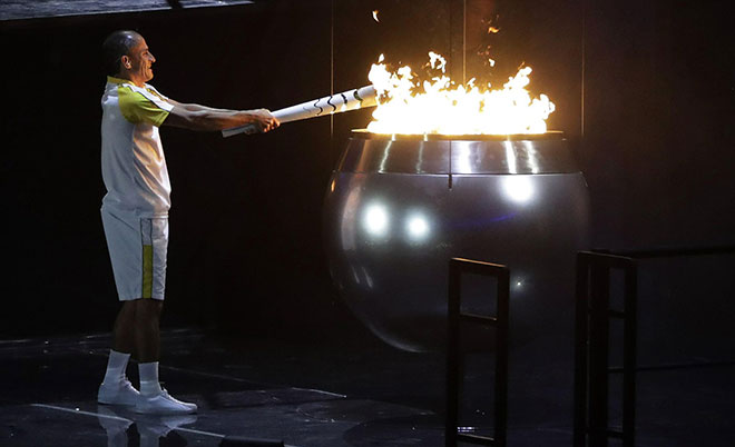 Vanderlei de Lima lights the Olympic flame during the opening ceremony for the 2016 Summer Olympics in Rio de Janeiro, Brazil, Friday, Aug. 5, 2016. (AP)