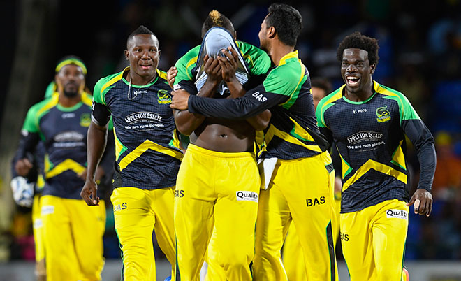 Andre Russell (centre) of Jamaica Tallawahs covers his face in celebration of Nic Maddinson of Guyana Amazon Warriors dismissal during Match 34 of the Hero Caribbean Premier League (CPL) – Final at Warner Park in Basseterre, St Kitts. (CPL/Sportsfile)