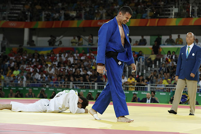 UAE's Sergiu Toma celebrates after defeating Italy's Matteo Marconcini during their men's -81kg judo contest bronze medal A match of the Rio 2016 Olympic Games in Rio de Janeiro on August 9, 2016. (AFP)