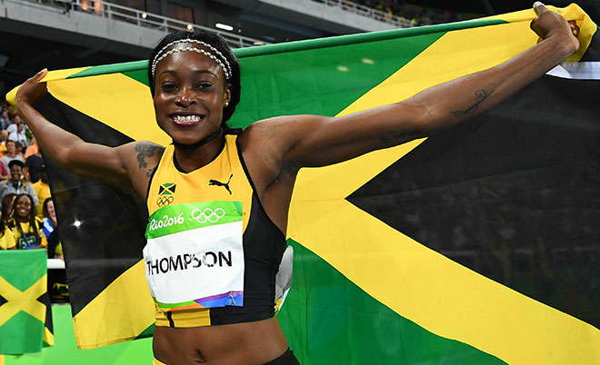 Jamaica's Elaine Thompson celebrates after she won the Women's 100m Final during the athletics event at the Rio 2016 Olympic Games at the Olympic Stadium in Rio de Janeiro on August 13, 2016.  (AFP)