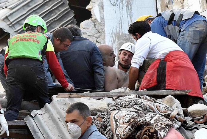 A man is extracted alive from a collapsed building following an earthquake in Amatrice, central Italy. REUTERS