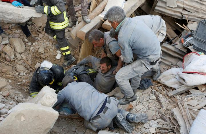 A man is rescued alive from the ruins following an earthquake in Amatrice, central Italy. REUTERS