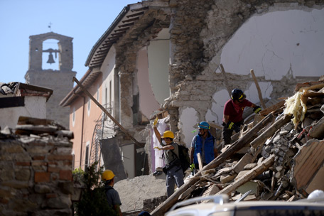 Volunteers work to move rubble and debris during search and rescue operations in Amatrice. (AFP)