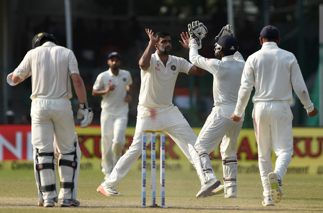 Ravichandran Ashwin (C) celebrates the wicket of New Zealand's captain Kane Williamson (L) with teammates Wriddhiman Saha (2R) and Virat Kohli (L) during the fourth day of the first Test match between India and New Zealand at Green Park Stadium in Kanpur. (AFP/Getty)