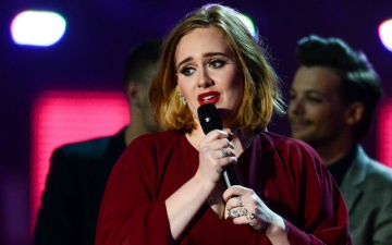 Photo: Adele is 'pouring her heart and soul' into her new record