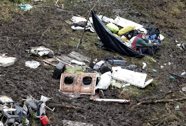 A rescue worker sits near the wreckage of a plane that crashed into the Colombian jungle with Brazilian soccer team Chapecoense onboard near Medellin, Colombia. (Reuters)
