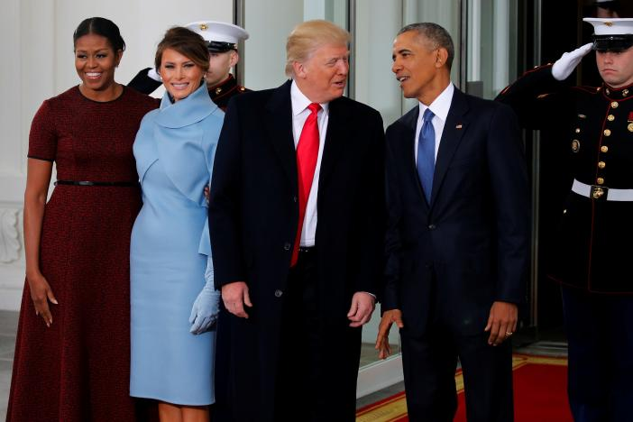 U.S. President Barack Obama (R) and first lady Michelle Obama (L) greet U.S. President-elect Donald Trump and his wife Melania for tea before the inauguration at the White House in Washington, U.S. January 20, 2017. REUTERS
