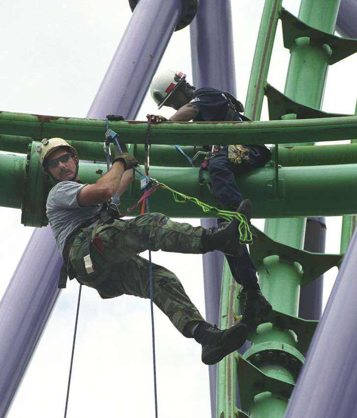 Rescuers pluck 24 passengers from stuck roller coaster