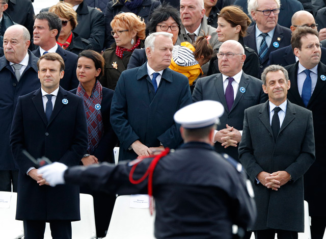 Former French President Nicolas Sarkozy, right, and French President-elect Emmanuel Macron. (AP)