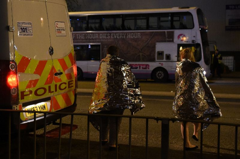 Concert goers wait to be picked up after a suspected terror attack during a pop concert by Ariana Grande in the northern English city of Manchester. (AFP)
