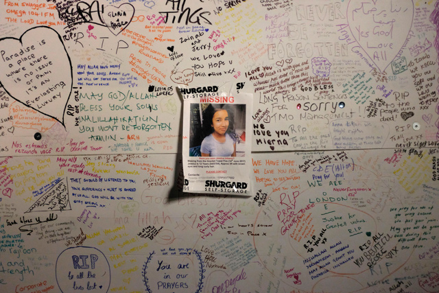 A missing poster is seen on a board with tributes following the blaze at Grenfell Tower, a residential tower block in west London. (AFP)